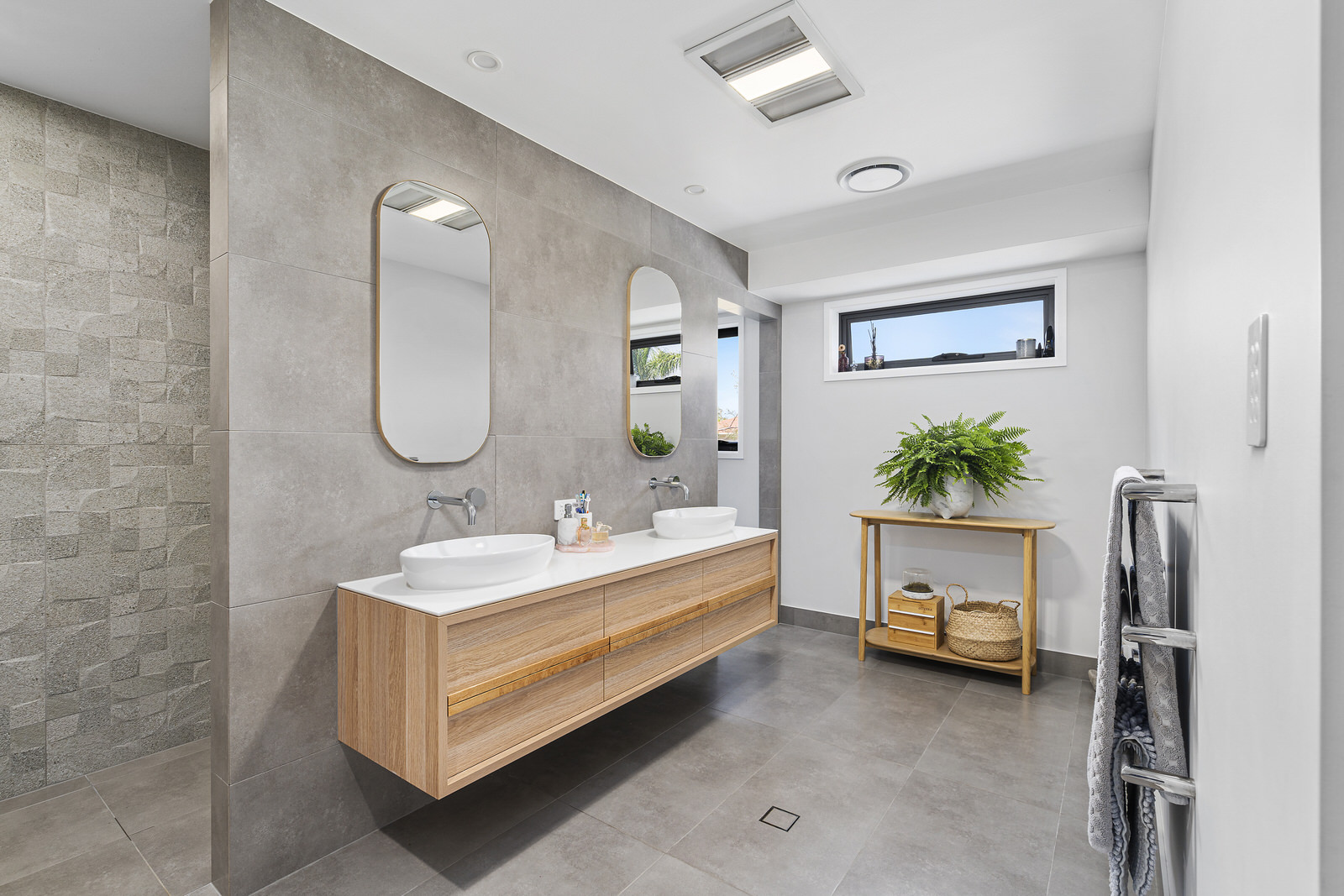 bathroom renovation modern design with grey, white and wood finishes