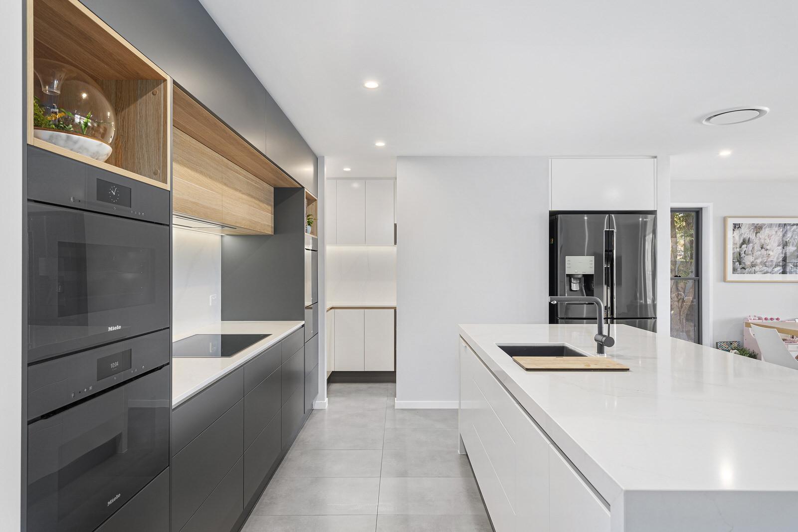 Sorrento kitchen renovation modern sleek design. Grey, white and wood finishes