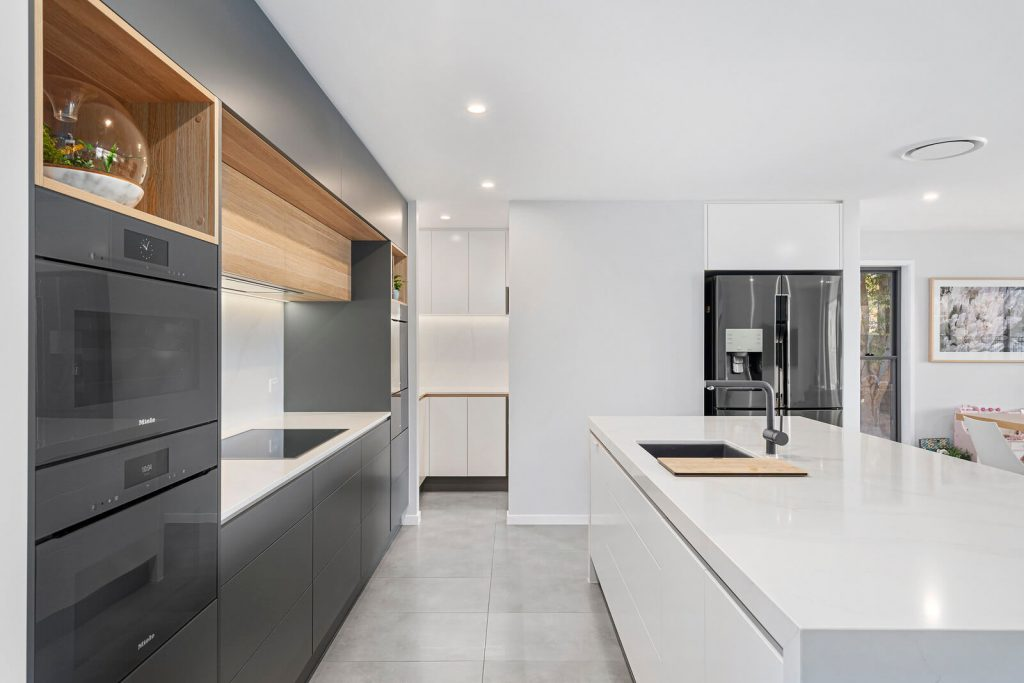 new kitchen with grey, white and natural wood colours